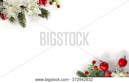 Christmas Decoration. Twigs Christmas Tree, Red Berries, Red Apples, White Openwork On White Backgro