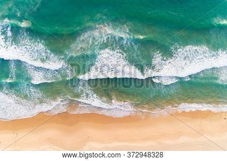 Aerial View Sandy Beach And Crashing Waves On Sandy Shore Beautiful Tropical Sea In The Morning Summ