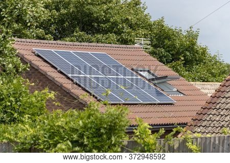 Bristol-may-2020-england-a Close Up View Of Solar Pannels On A Roof Of A Home In Bristol