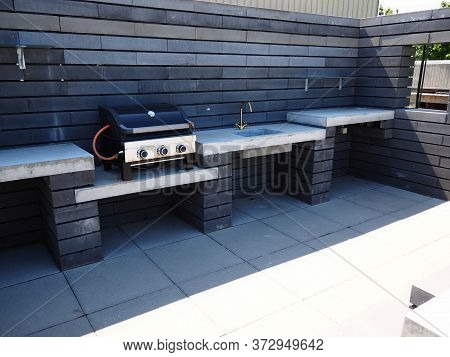 Stylish Modern Design Outdoors Garden Pation Kitchen With Gas Barbecue And Sink Made Of Black And Wh