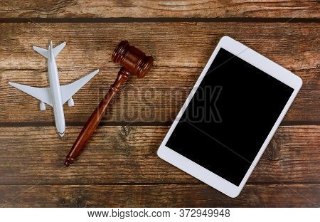 Judge Traveling Concept Planning Airplane In Wooden Judges Gavel With Digital Tablet On Airplane Mod