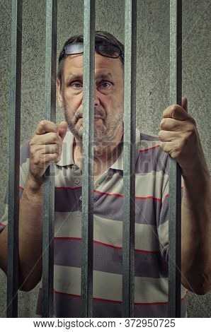 Accused Mature Adult Man In A Criminal Case Is Placed Into A Pre-trial Detention Cell
