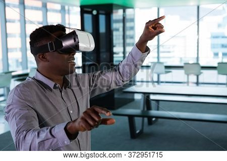 Man using virtual reality headset in futuristic office