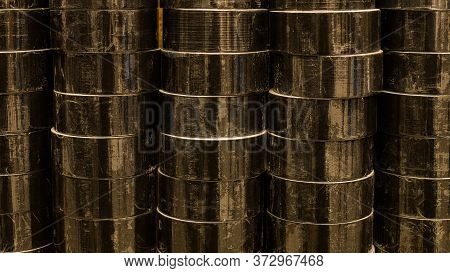 Coils Of Colored Insulating Tape Or Scotch Tape In A Row. Indastrial Black Tape. Construction Electr