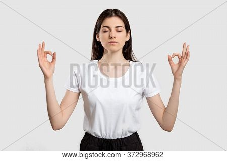 Yoga Portrait. Zen Patience. Calm Woman Meditating With Closed Eyes Isolated On Neutral Background.