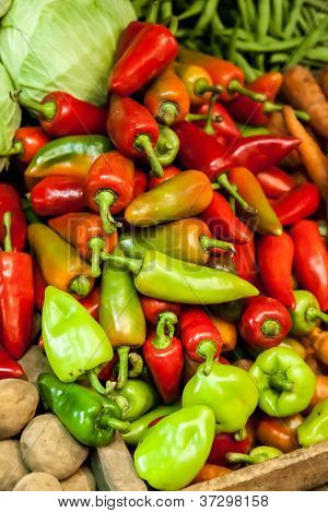 Red And Green Peppers (capsicum) At The Market