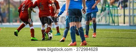 Sporty Football Boys Running After Ball In Duel. Horizontal Football Background. School Soccer Compe