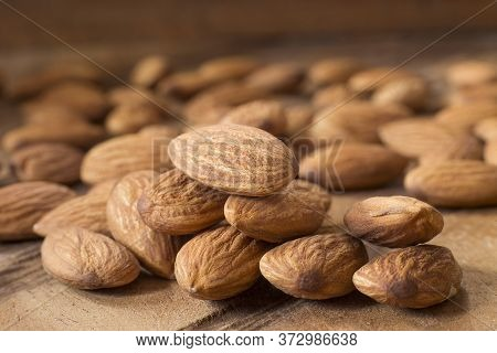 Tasty Almonds Nuts - Prunus Dulcis. Wood Background