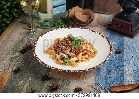 Pappardelle With Meat And Grated Parmesan Cheese, Horizontal