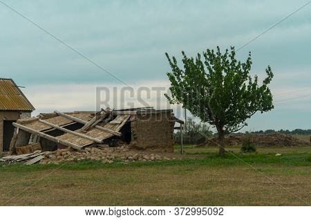 Ruined House In The Village. The Ruins Of An Old House, A House Made Of Clay. The Collapse Of The Ro