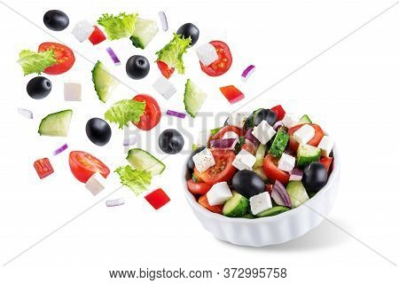Greek Salad In A Bowl On A White Isolated Background