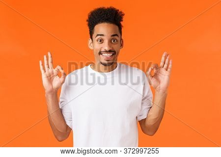 Guy Left Satisfied With Peformance. Happy Delighted African American Man In White T-shirt Show Okay