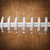 A photoshop generated background of a close up of football laces. poster
