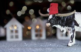 Toy Bull As Symbol Of 2021 Year. Happy New Year Concept. Sparkling Greeting Card. The Ox And Toy Hou