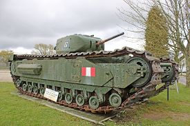 Vintage Military Tank Standing In A Field