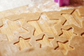 Star Shaped Gingerbread Cookie On A Wooden Board. Christmas Dessert. The Process Of Baking Cookies.