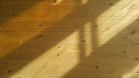 Sanding A Wooden Floor On A Sunny Day.