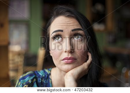 Beautiful Young Woman With Pensive Expression