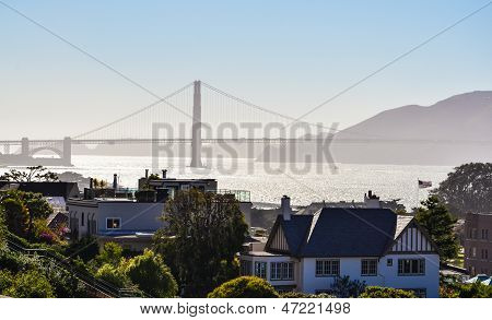 Silhouetted view of Golden Gate Bridge from Franklin Street in San Francisco