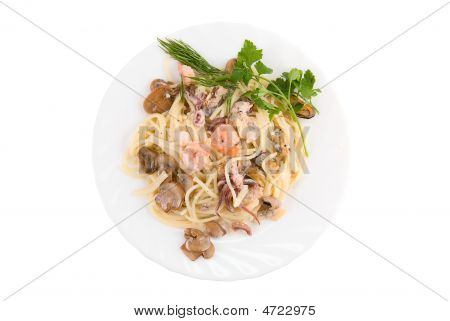 Pasta with seafood and mushrooms on white plate poster