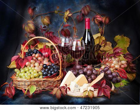 Beautiful Still Life With Wine Glasses, Grapes, Pomegranate On The Table