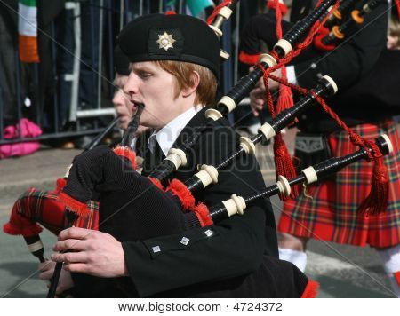 Irishmen In His Kilst Is Playing On Bagpipe During The St. Patrick's Day Parade Held March 16, 2009.
