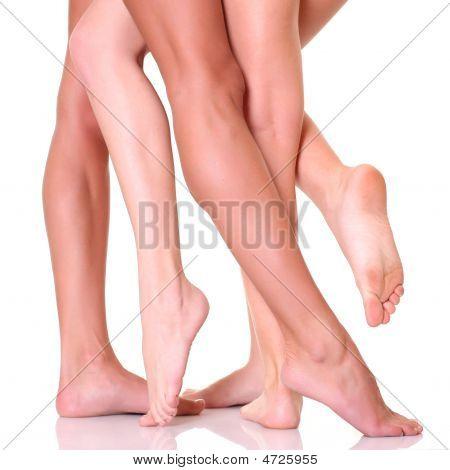 Three Pairs Female Feet Close Up