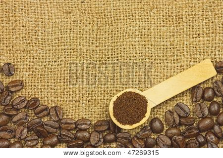 Coffee ground in spoon on coffee seeds and sack poster