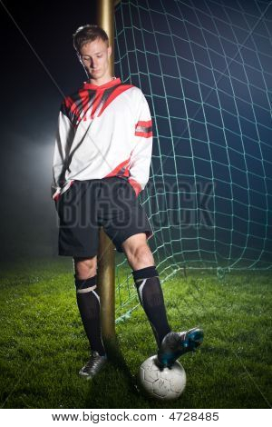 Soccer Player Relaxing In The Dark Stadium