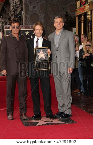 LOS ANGELES - JUN 24:  Johnny Depp, Jerry Bruckheimer, Bob Iger at  the Jerry Bruckheimer Star on the Hollywood Walk of Fame  at the El Capitan Theater on June 24, 2013 in Los Angeles, CA