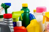Brightly colored plastic bottles with tops - detergent to poison poster