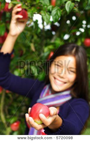 Woman Giving Apple