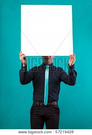 close up of man hands showing white blank board