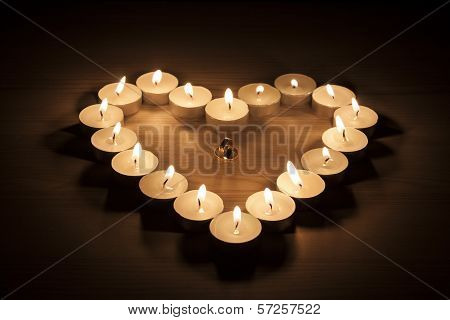 Wedding Ring In A Heart Of Candles
