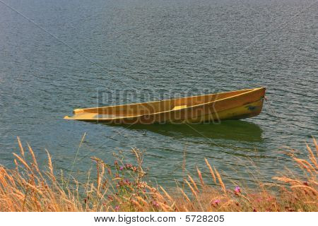 Yellow boat on the lake