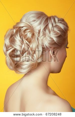 Hairstyle. Beauty Blond Girl Bride With Curly Hair Styling Over Yellow Background