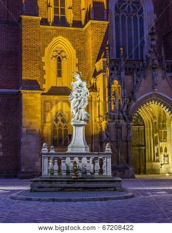 Night Photo Of Of Holu Mother Statue In Front St. John`s Cathedral, Wroclaw, Poland