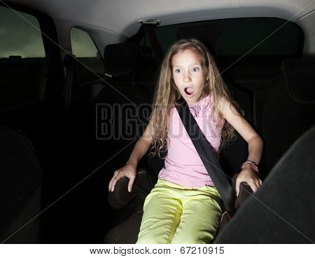 Child in car. Shocked girl. Accident