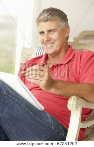 Mid age man sketching