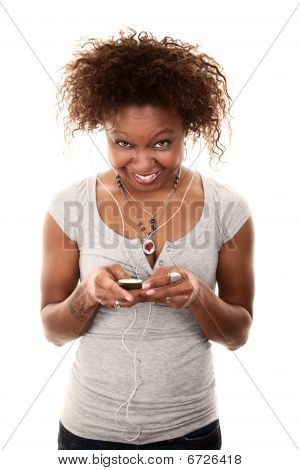 Pretty African-american Woman With Personal Listening Device