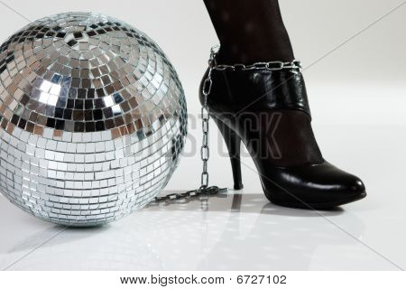 mirrored disco ball as fetters enchained to leg poster