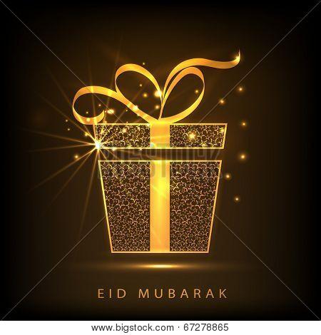 Shiny golden gift box with ribbon on brown background for muslim community festival Eid Mubarak celebrations.
