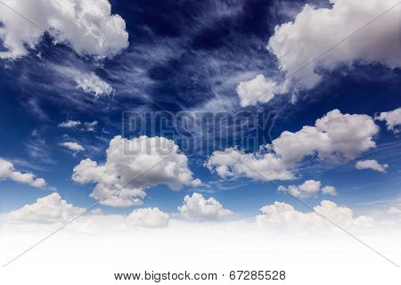 White fluffy clouds in the fantastic blue sky. Overcast sky before storm.