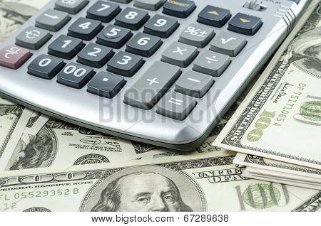 Calculator on a background of american dollar bills