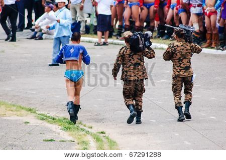 Mongolian Wrestler Walks With Soldiers At Nadaam Opening Ceremony