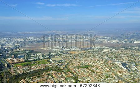 Aerial view of Mission Hills neighborhood and San Diego International Airport (Lindbergh Field) in Southern California United States of America. An upscale affluent area in the city. poster