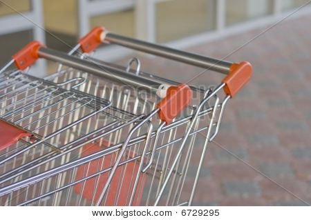 Two Empty Carts In A Supermarket