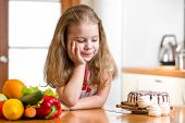 kid choosing between healthy vegetables and tasty sweets poster