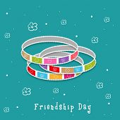 Colorful bangles on floral decorated green background for Happy Friendship Day celebrations.  poster