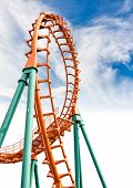 Rail of the roller coaster on blue sky background poster